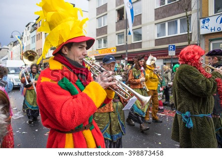 COLOGNE, GERMANY - FEBRUARY 9, 2016: Musicians play horns in the parade during the Carnival of Cologne - stock photo