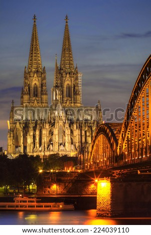 Cologne, Germany. Image of Cologne with Cologne Cathedral during twilight blue hour.  - stock photo