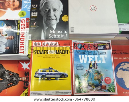 Cologne,Germany- January 19, 2016: Popular german magazines in german language on display in a store in Cologne,Germany - stock photo