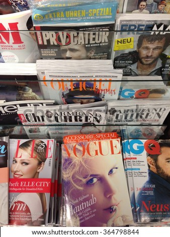 Cologne,Germany- July 24,2013: Popular german magazines in german language on display in a store in Cologne,Germany - stock photo