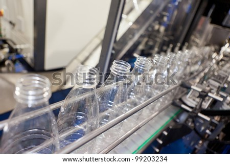 COLOGNE, GERMANY - MARCH 27 : New SB Uniline 6000 bottle unscrambler on display at the SMF booth at the ANUGA FoodTec industry trade show in Cologne, Germany on March 27, 2012. - stock photo