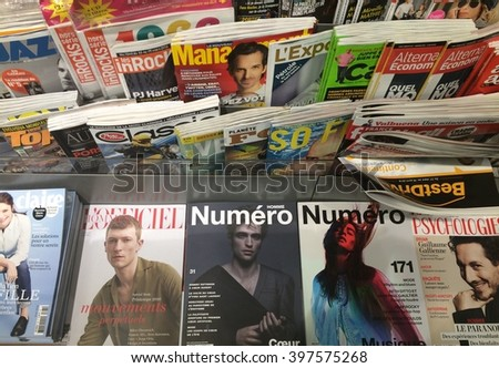 Cologne,Germany- March 29,2016: Polular french magazines in a store in Cologne,Germany - stock photo