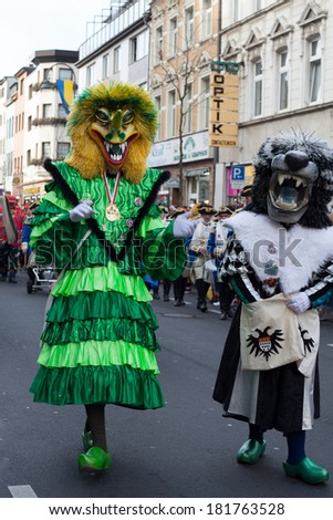 "Cologne, Germany - March 4th, 2014: Carneval Cologne 2014: Two creatures are part of the carnival parade called ""Ehrenfelder Dienstagzug""."