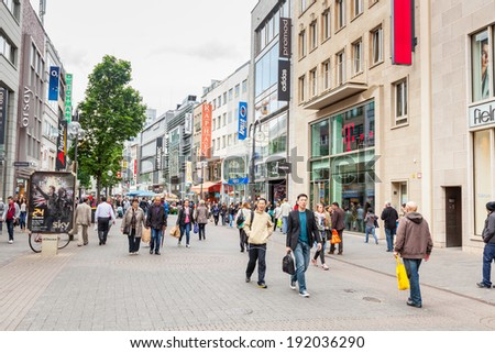 COLOGNE, GERMANY - MAY 07, 2014: Crowded shopping street in Cologne - stock photo