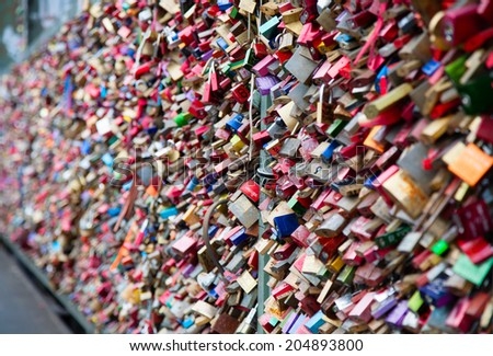 COLOGNE, GERMANY - MAY 29, 2014, Thousands of love locks which sweethearts lock to the Hohenzollern Bridge to symbolize their love on May 29 in Koln, Germany  - stock photo