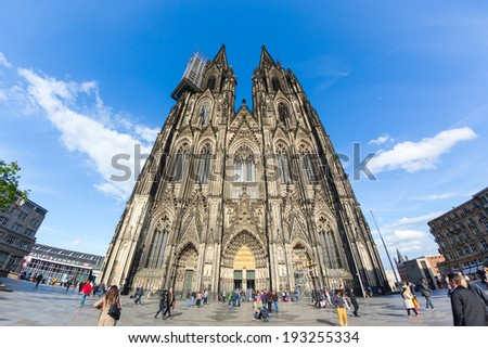 COLOGNE, GERMANY - MAY 07, 2014: Tourists in front of gothic Cathedral of the city.