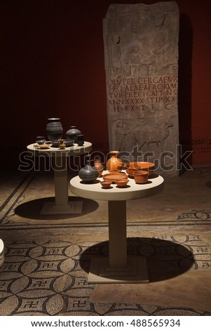 COLOGNE, GERMANY - SEP 15, 2016 - Ancient glass vases and pottery,  Roman - Germanic Museum,  Cologne, Germany