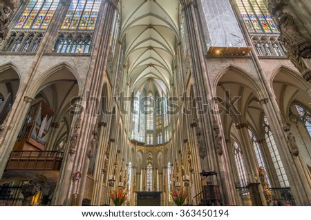 COLOGNE, GERMANY - SEP 17, 2015: Interior of the Cologne Cathedral. Roman Catholic cathedral in gothic style. Nave, ceiling, organ, columns and stained glass. World Heritage Site. - stock photo
