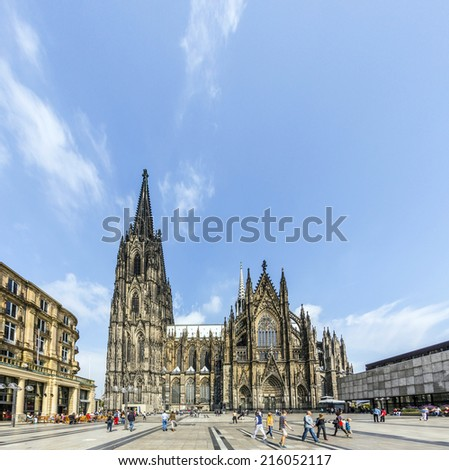 COLOGNE, GERMANY- SEP 7, 2014: Tourists and residents in front of the Cologne Cathedral in Cologne, Germany. It is Germanys most visited landmark visited by 20.000 people a day.