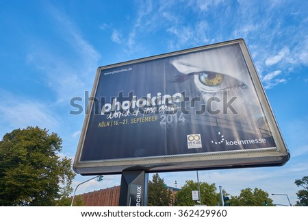 COLOGNE, GERMANY - SEPTEMBER 19, 2014: Photokina advertisement. The Photokina is the world's largest trade fair for the photographic and imaging industries - stock photo