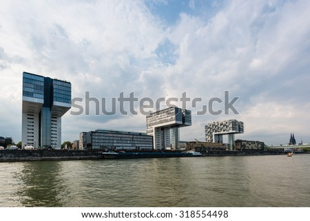 COLOGNE, GERMANY - SEPTEMBER 12, 2015: Rheinau harbor in Cologne, Germany, with the crane houses buildings as seen from the water. - stock photo
