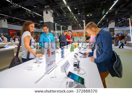 COLOGNE, GERMANY - SEPTEMBER 19, 2014: Samsung stand in the Photokina Exhibition. The Photokina is the world's largest trade fair for the photographic and imaging industries - stock photo
