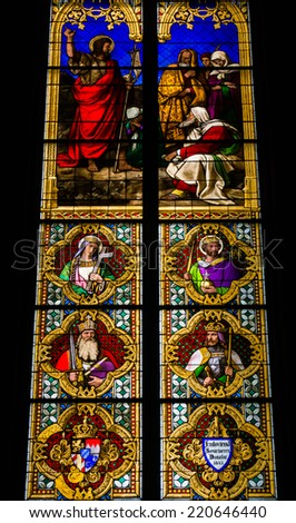 COLOGNE, GERMANY - SEPTEMBER 21: Stained glass church window with Pentecost theme in the cathedral on September 21, 2014 in Cologne - stock photo