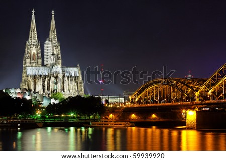 Cologne Gothic Cathedral at night as seen from the Rehin - stock photo