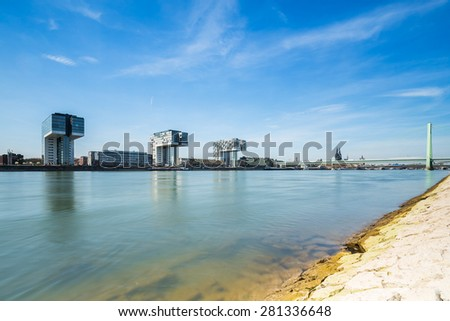 Cologne Rhine-shore with Cathedral and crane houses - stock photo