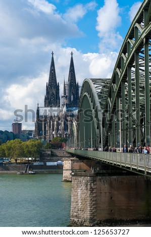 COLOGNE - SEPT 22: Hohenzollern bridge on sept 22, 2012 in Cologne. It is now a rail bridge with six tracks, and due to its location near the main train station about 1200 trains pass here every day.