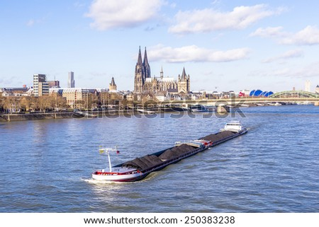 Cologne skyline with dome and bridge under blue sky - stock photo
