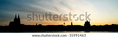 Cologne sunset panorama. Back lit. - stock photo
