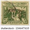 COLOMBIA - CIRCA 1956: A stamp printed in Colombia, shows Cacao picker, Cauca, circa 1956 - stock photo