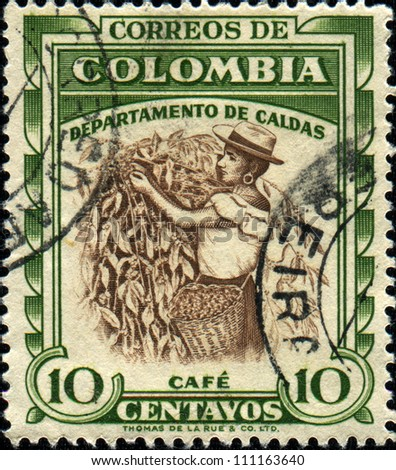COLOMBIA - CIRCA 1940: A stamp printed in Colombia shows coffee harvesting, circa 1940 - stock photo
