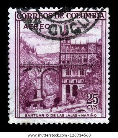 COLOMBIA - CIRCA 1954: A stamp printed in Colombia shows Las Lajas Sanctuary, minor basilica church in the southern Colombia, Narino, red, circa 1954 - stock photo