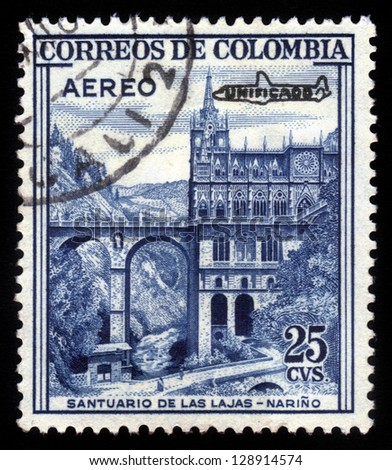 COLOMBIA - CIRCA 1954: A stamp printed in Colombia shows Las Lajas Sanctuary, minor basilica church in the southern Colombia, Narino, blue, circa 1954 - stock photo