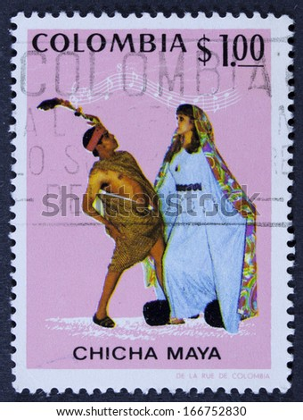 COLOMBIA - CIRCA 1971 a stamp printed in the Colombia shows Dancers and Music, Currulao, Chicha Maya Dancers and Music, circa 1971  - stock photo
