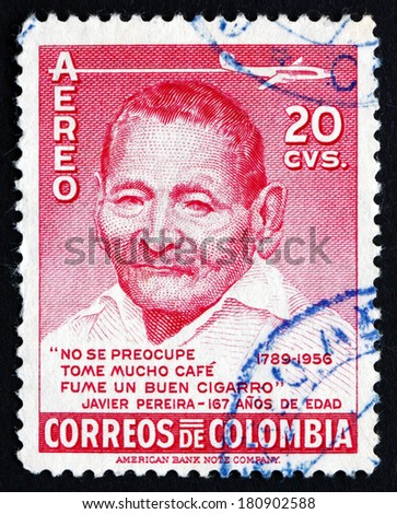 COLOMBIA - CIRCA 1956: a stamp printed in the Colombia shows Javier Pereira, Zenu Indian, was over 160 Years Old at Time of His Death, circa 1956 - stock photo