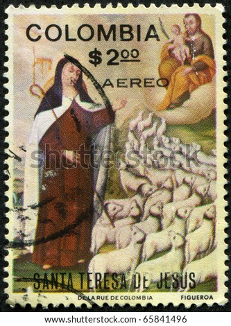 COLOMBIA - CIRCA 1980-s: A greeting Christmas stamp printed in Colombia shows paint by Santa Teresa de Jesus, circa 1980-s - stock photo