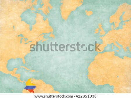 Colombia (Colombian flag) on the map of North Atlantic Ocean. The Map is in vintage style and sunny mood. The map has soft grunge and vintage atmosphere, like watercolor painting on old paper.  - stock photo