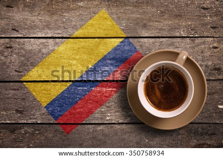 Colombia flag with coffee on table. top view - stock photo