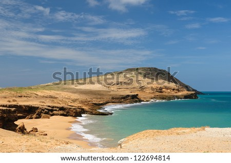 Colombia, wild coastal desert of Penisula la Guajira near  the Cabo de la Vela resort. The picture present beautiful Pilon de Azucar beaches of the Caribbean coast with turquoise water and orange sand