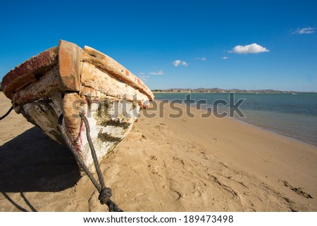 Colombia, wild coastal desert of Penisula la Guajira near the Cabo de la Vela resort. The picture present traditional fishing boat on the beach made of the one-piece tree. Colombia 2014. - stock photo