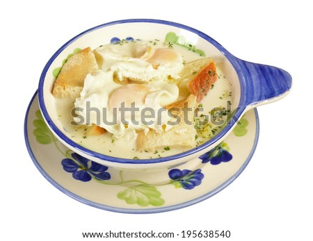 Colombian cuisine. Changua, Milk,bread and fried eggs. - stock photo