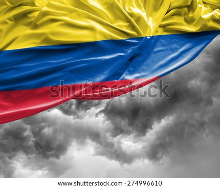 Colombian waving flag on a bad day - stock photo