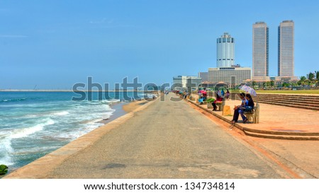 COLOMBO, SRI LANKA - MARCH 16: Colombo skyline and famous Galleface beach on March 16, 2013 in Colombo. Hundreds of people enjoy this beach everyday. World trade center is also visible in background.