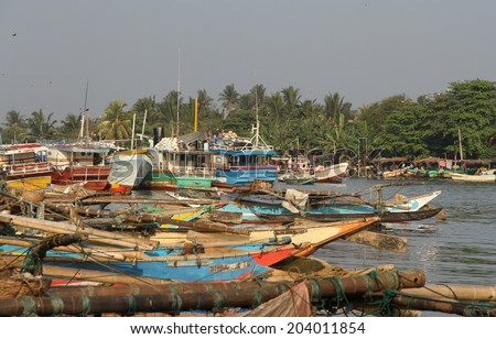 COLOMBO, SRI LANKA - MARCH 1: Local fishermen and their boats in the lagoon near the fish markets of Negombo, near Colombo, Sri Lanka on the 1st March, 2014.