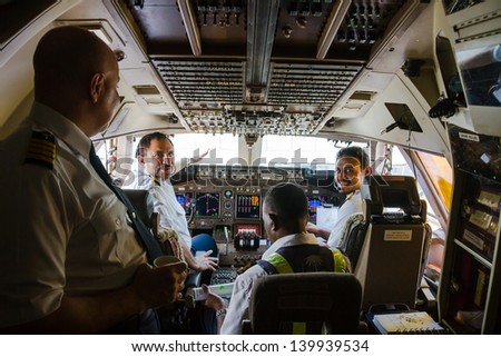 COLOMBO, SRI LANKA - MARCH 27: pilots prepare the plane Boening 747 to take off before a flight to Jeddah, Saudi Arabia on March 27, 2013. Cockpit with pilots of the flight. - stock photo