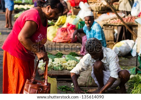 COLOMBO, SRI LANKA - MARCH 13: Traditional street market on March 13, 2013 in Colombo, Sri Lanka. Street market is the component of traditional Sri Lankan culture. - stock photo