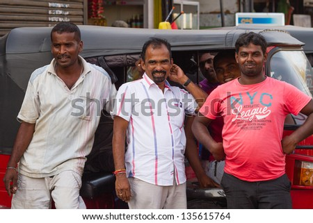 COLOMBO, SRI LANKA - MARCH. 13: Workers of Sri Lankan traditional taxi on March 13, 2011 in Colombo. Colombo is the largest city and former capital of Sri Lanka with population about 1 million people. - stock photo