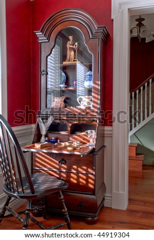 Colonial American style house interior with old desk and antique Windsor chair in a historic home