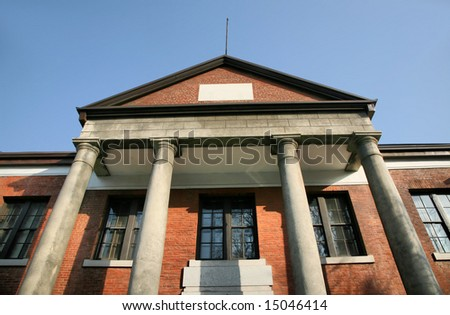 Colonial Era Asian Building with Columns against blue sky