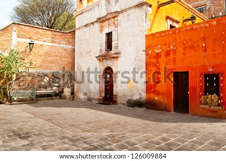 Colonial era buildings surround a courtyard in central Mexico - stock photo