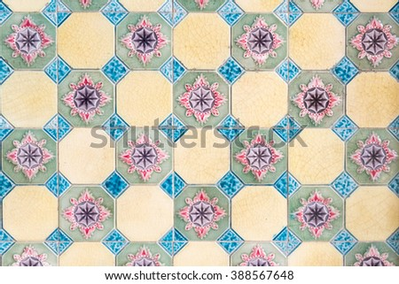 Colonial house architecture vintage floor tiles with pink flowers as a decorative design - stock photo