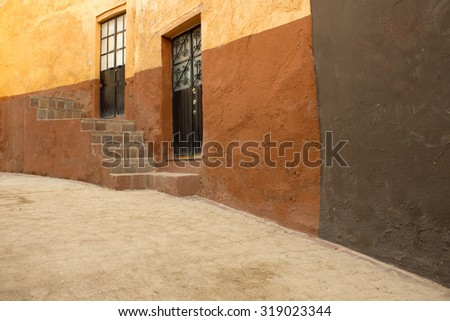 Colonial painted wall Wall of House Facade in Guanajuato, Mexico - stock photo