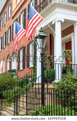 Colonial Red Brick Architecture with American Flags - stock photo