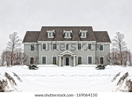colonial style home in wintertime - stock photo