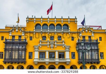Colonial yellow building at main square called Plaza de Armas, Lima, Peru - stock photo