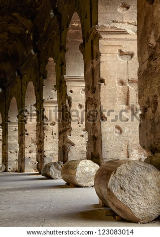 Colonnade of Colosseum the most well-known and remarkable landmark of Rome and Italy - stock photo