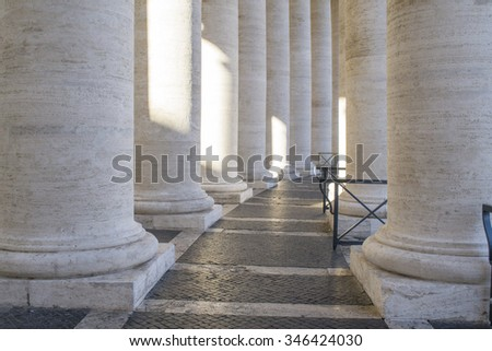 colonnade of st peter square in Rome - stock photo
